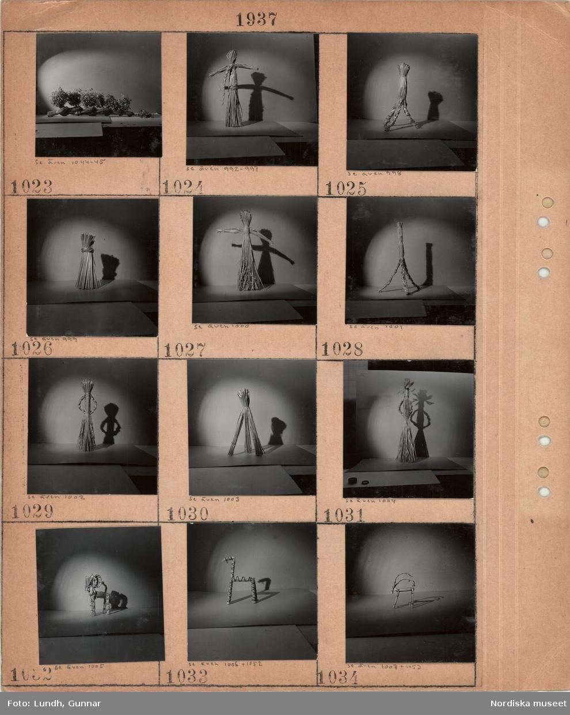 Motiv: Olika figurer gjorda av halm, stiliserade människofigurer, olika bockar m.m.