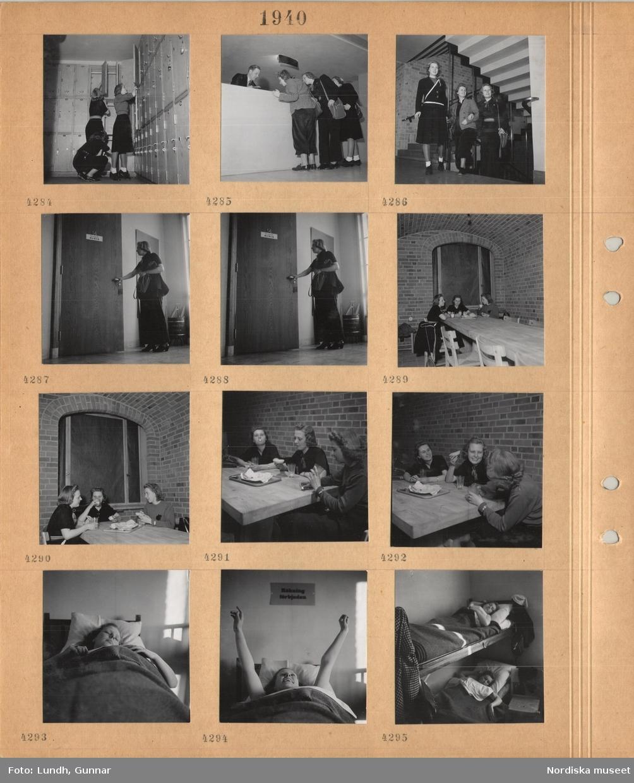 """Motiv: Stockholm, vandrarhem, tre kvinnor vid låsbara förvaringsskåp, tre kvinnor vid en receptionsdisk, tre kvinnor i en trapphall, kvinna står vid en dörr i en korridor, brandredskap i hörnet, tre kvinnor sitter och äter vid ett stort bord i ett rum med tegelväggar och valvtak, kvinnor ligger i sängar, skylt med """"Rökning förbjuden"""" på väggen."""