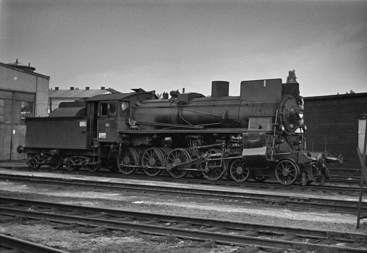 Damplokomotiv type 26c nr. 412 ved lokomotivstallen på Hamar.
