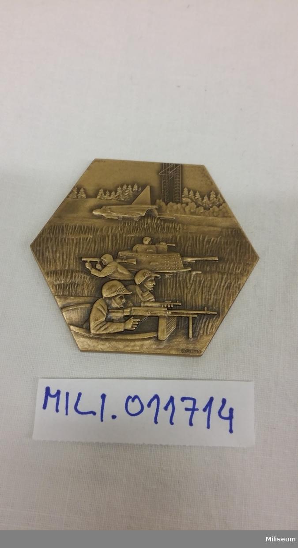 Jubileumsplakett av brons.