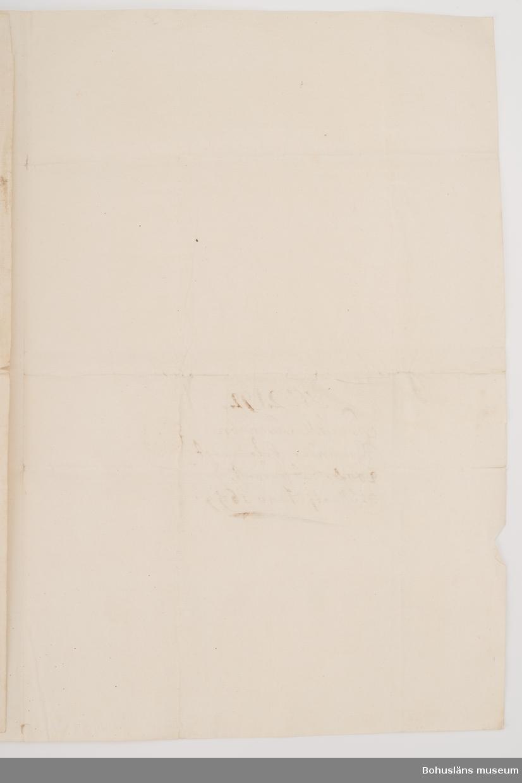 Pantförskrivning av fastighet i Uddevalla 1699. Borgensförbindelse 1699. Fastigheten belägen i Gietegränden, ägare Daniel Swensson.  Ur handskrivna katalogen 1957-1958: Dokument mm. Lånekvitto, Borgensförbindelse. (1 mynt saknas)  Lappkatalog: