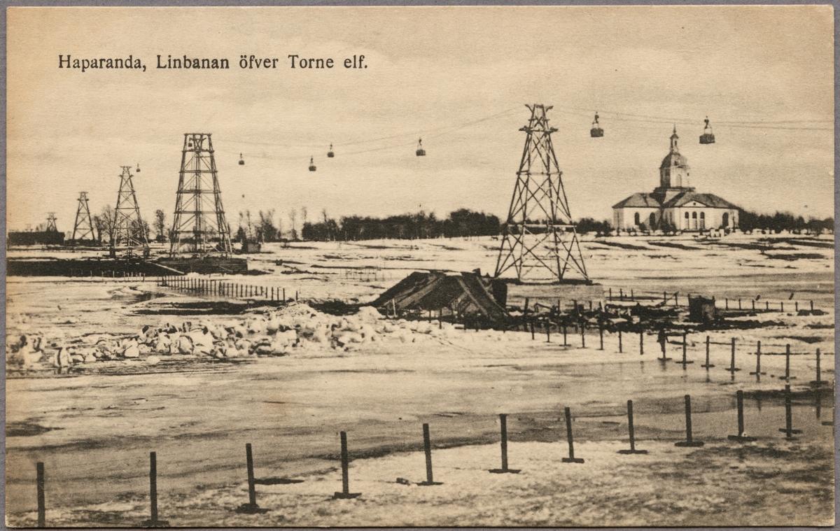 Postlinbanan över Torneälven mellan Haparanda och Torneå 1916-1918. Torneå kyrka syns på bilden.
