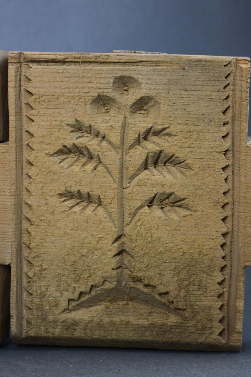 Plante og ornamentalsk mønster på innsiden av plater og hatt