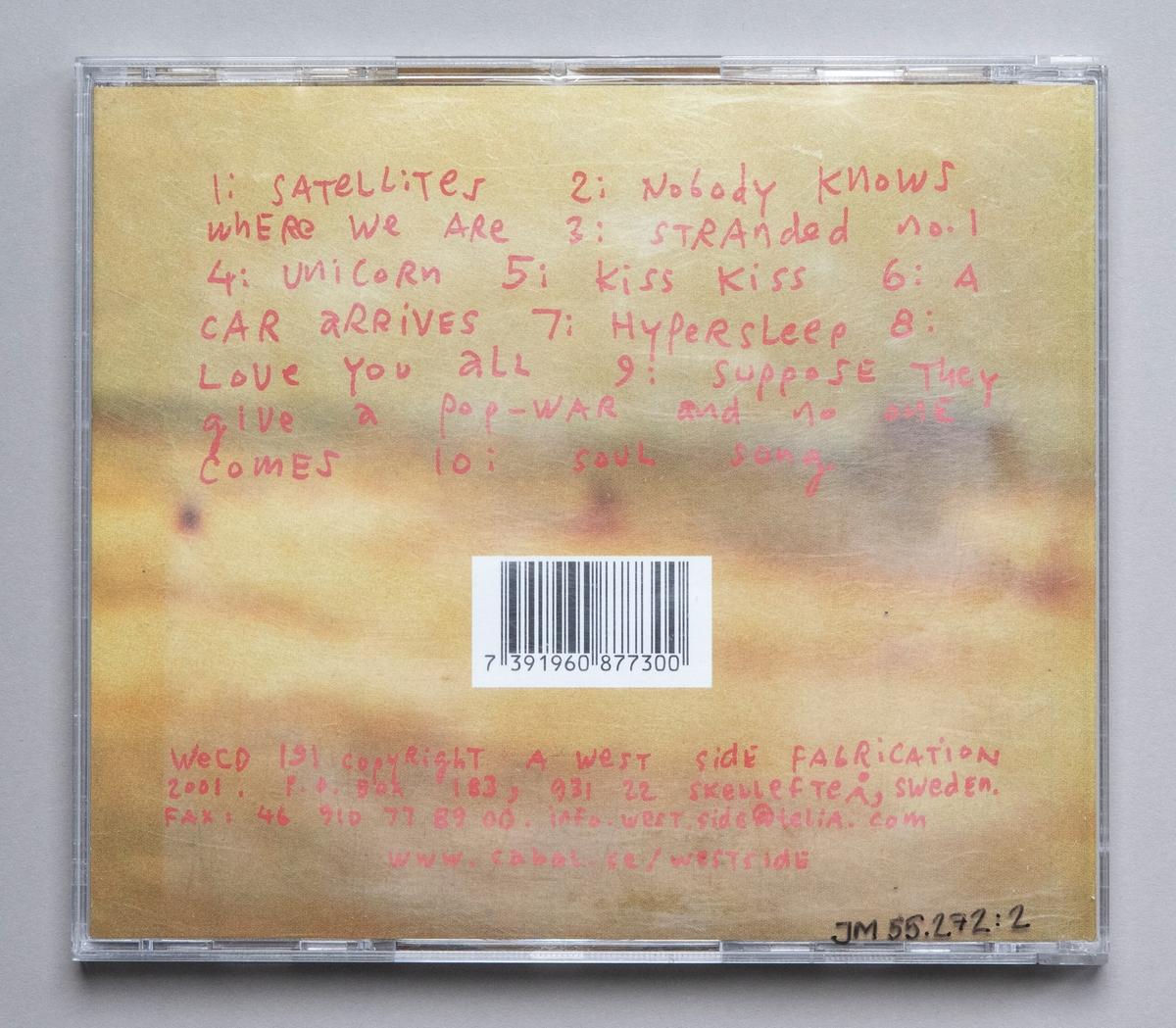 CD-skiva i tredelat, hårt plastfodral med inlaga i framsidan (vikt pappersark) och i baksidan.  Innehåll: 1. Satellites 2. Nobody Knows Where We Are 3. Strandes no. 1 4. Unicorn 5. Kiss Kiss 6. A Care arrives 7. Hypersleep 8. Love You All 9. Suppose they give a Pop-war and no one comes 10. Soul Song  JM 55272:1, Skiva JM 55272:2, Fodral JM 55272:3, Inlaga