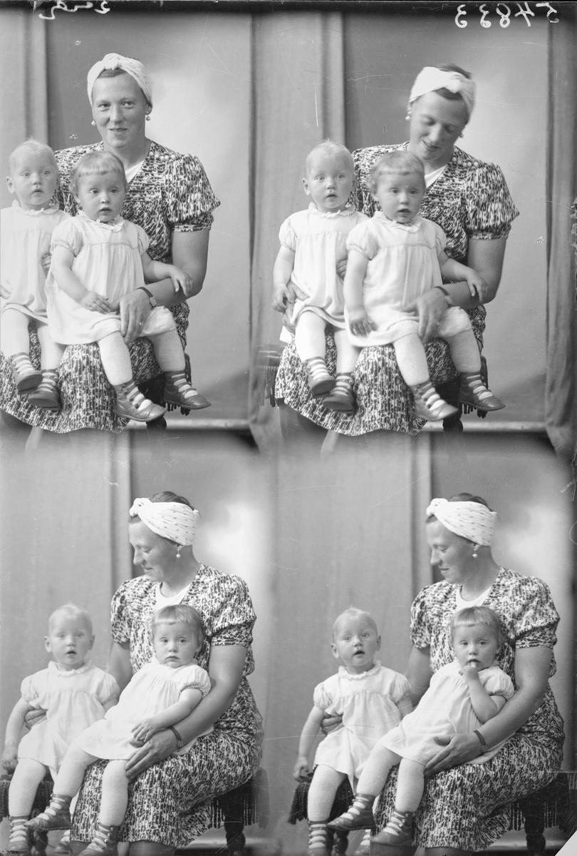 Portrett. Familiegruppe på tre. Ung kvinne i kortermet blomstret sommerkjole, perlekjede, perleøredobber og lyst hodeplagg. To små lyshårede piker i kortermede lyse kjoler og lyse strømpebukser. Sittende på en brodert stol. Mor og barn. Tvillinger.To foto med alle tre. To foto med mor og den ene tvillingen. Bestilt av Fru Kristine Brock. Haugev. 77