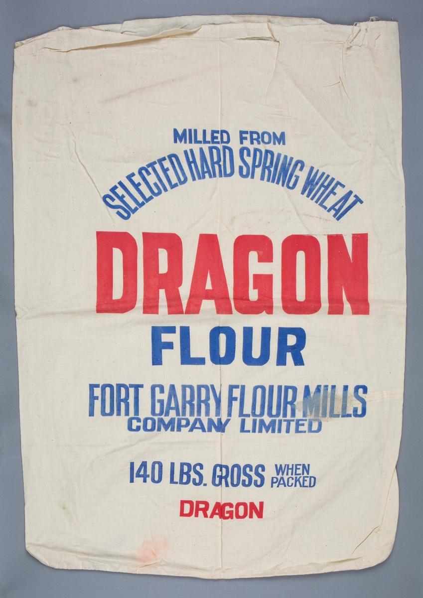 Melsekker i hvit lin med tekst. Benyttet til transport av hvetemel.