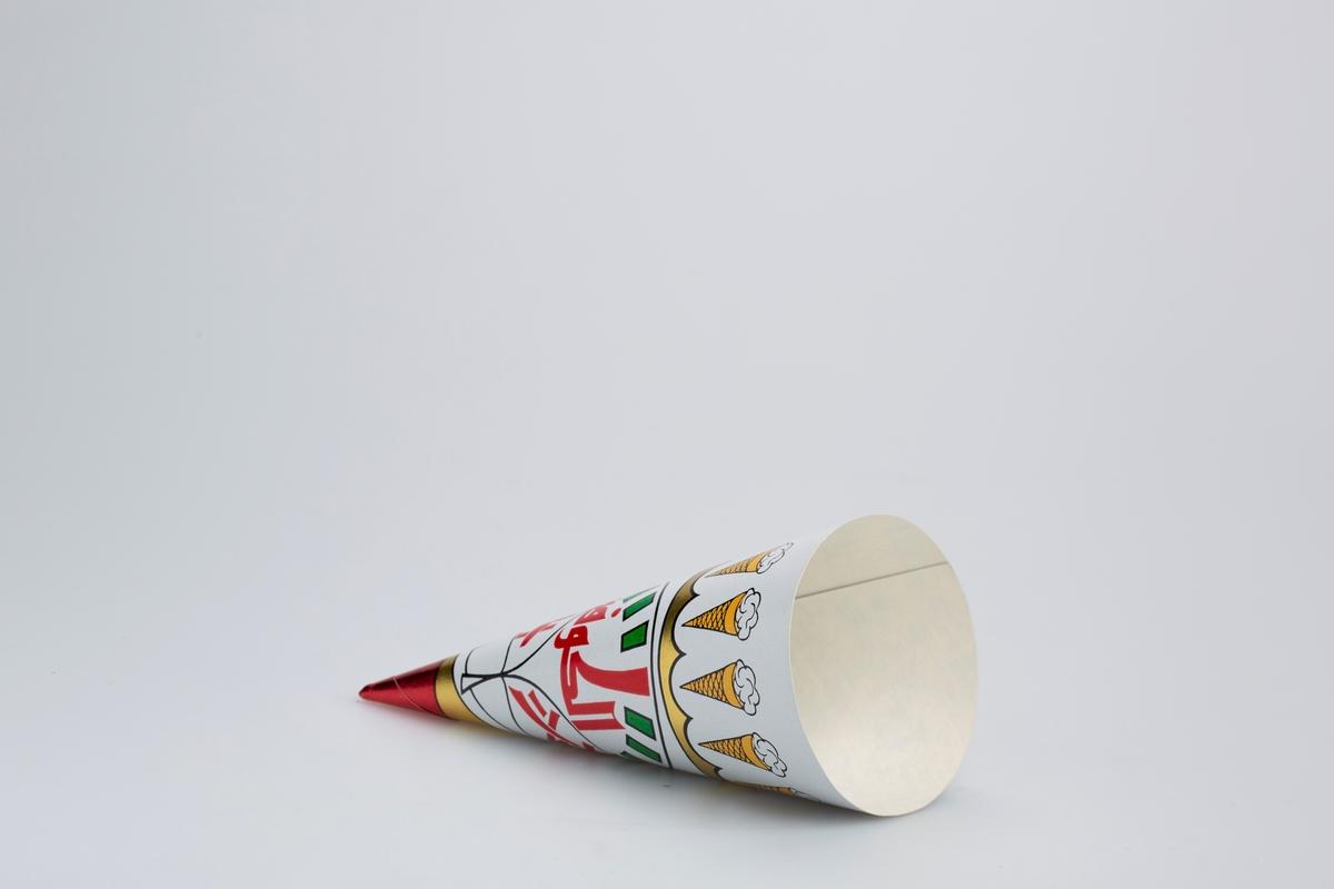 Iskrembord mot hvit bakgrunn øverst. Arabisk(?) skrifttegn på midten. Tuppen av kremmerhuset er metallisk rød.