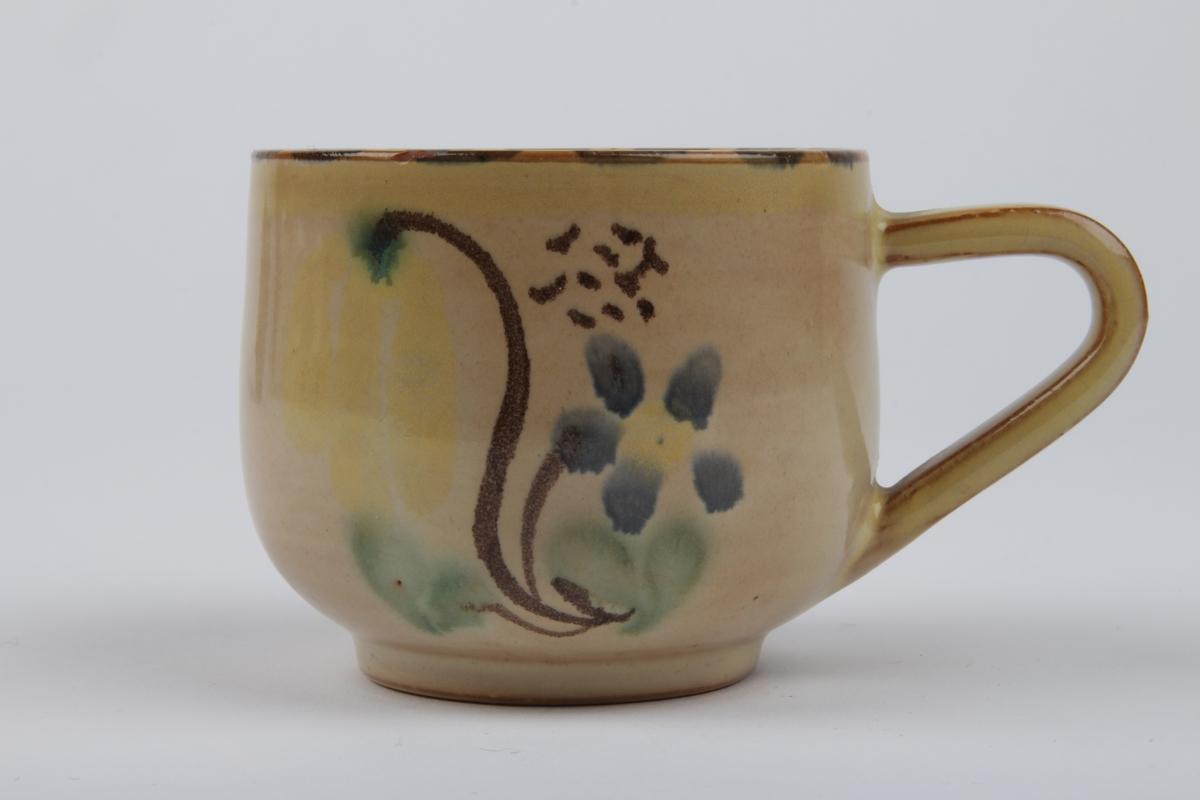 Kaffekopp med dekor.