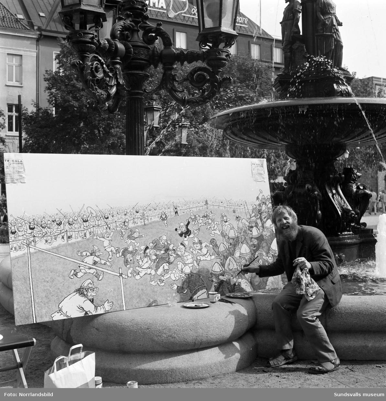 Sundsvallskonstnären Rolf Lidberg målar trolltavlor i Vängåvan.