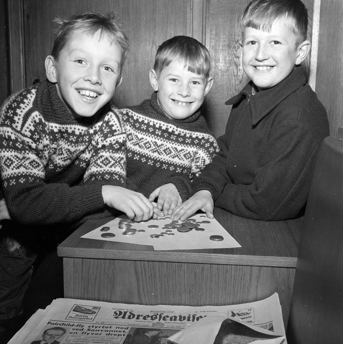 Tre gutter fra jernbanebyen på Heimdal med penger til gamle og syke tjent på snømåking