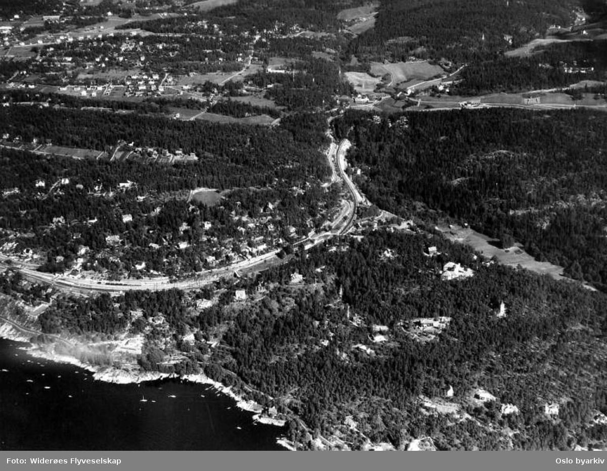 Ljansbruket / Tofte tømmerterminal, mellom Hvervenbukta og Bestemorstranda, Ljansbrukveien (Flyfoto)
