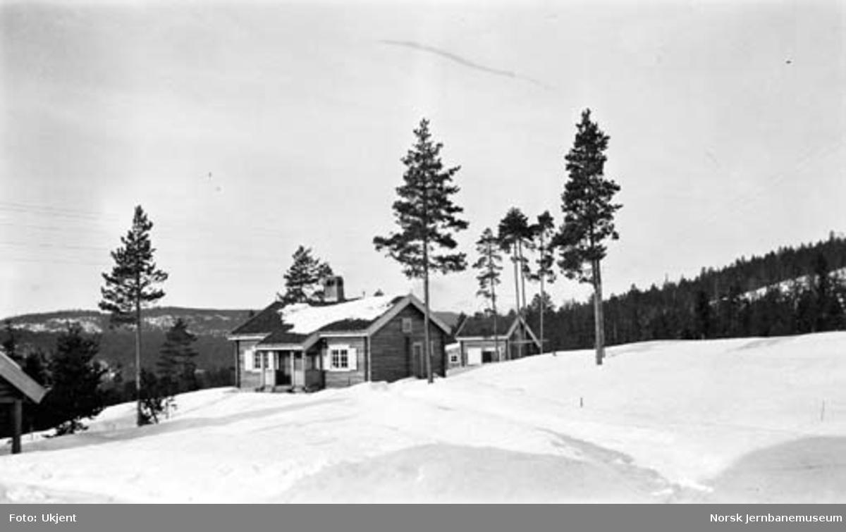Hytter, trolig i traktene mellom Kongsberg og Hjuksebø