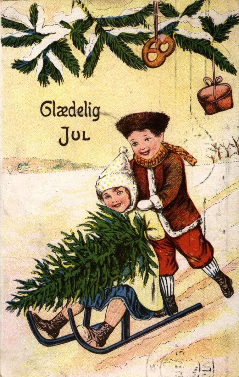 Julekort. Jule- og nyttårshilsen. Vintermotiv. Barn på spark med juletre. Stemplet 23.12.1911. Tysk kort.
