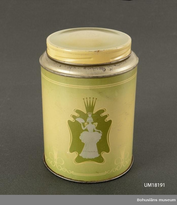 """594 Landskap BOHUSLÄN  Cylindrisk kaffeburk med skruvlock. Dekor i brungrönt och grönt. Fantasibild av prinsessa inom kartusch å ömse sidor. På locket """"ICA""""."""
