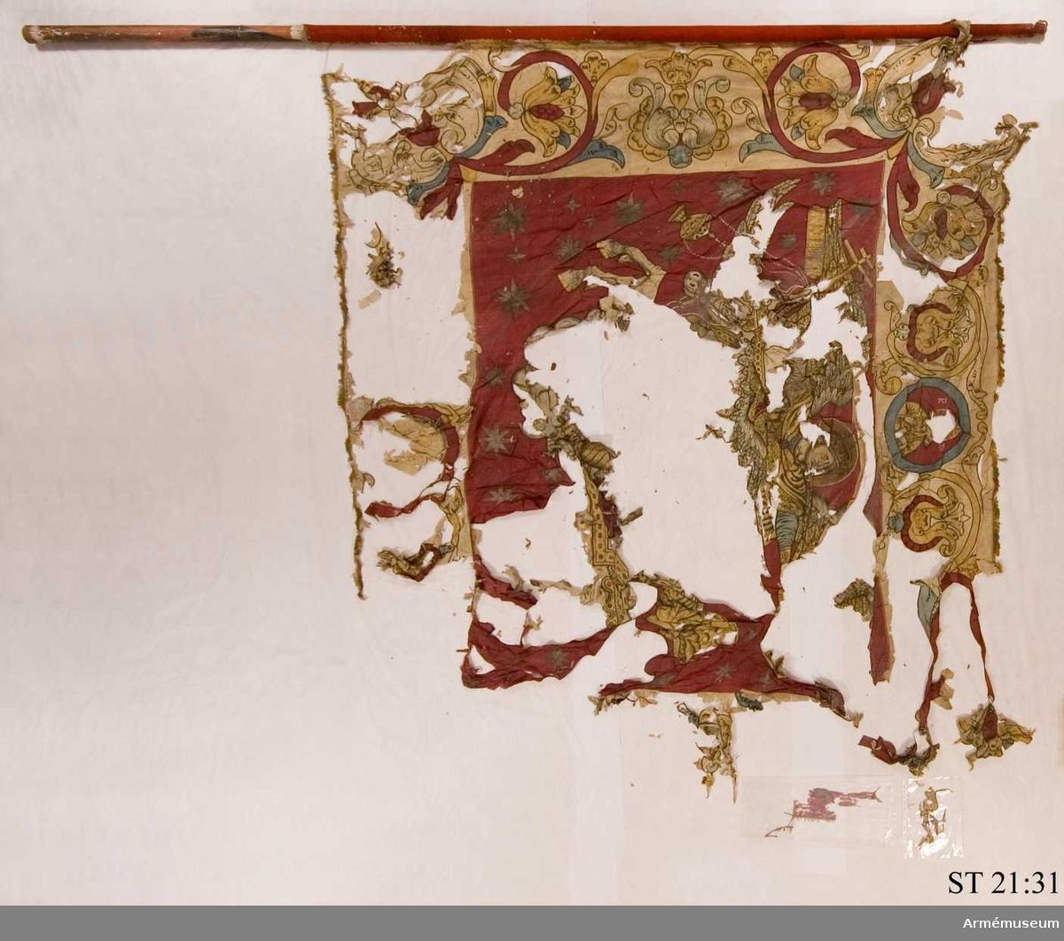 Fanans huvudmotiv är Sankt Mikael, apokalypsens ärkeängel.