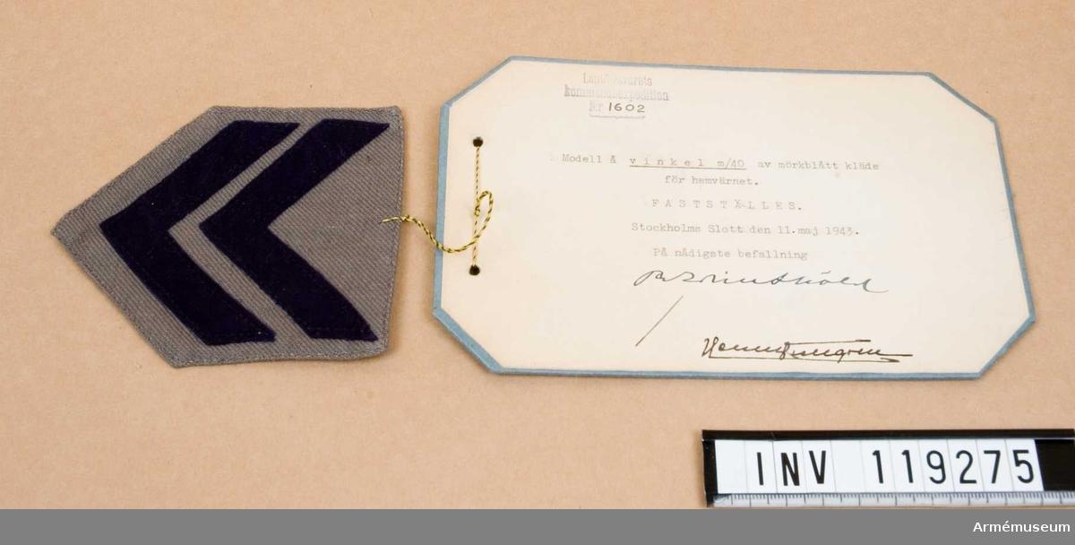 Vinkel m/1940 av mörkblått kläde för Hemvärnet. Fastställd 11/5 1943.