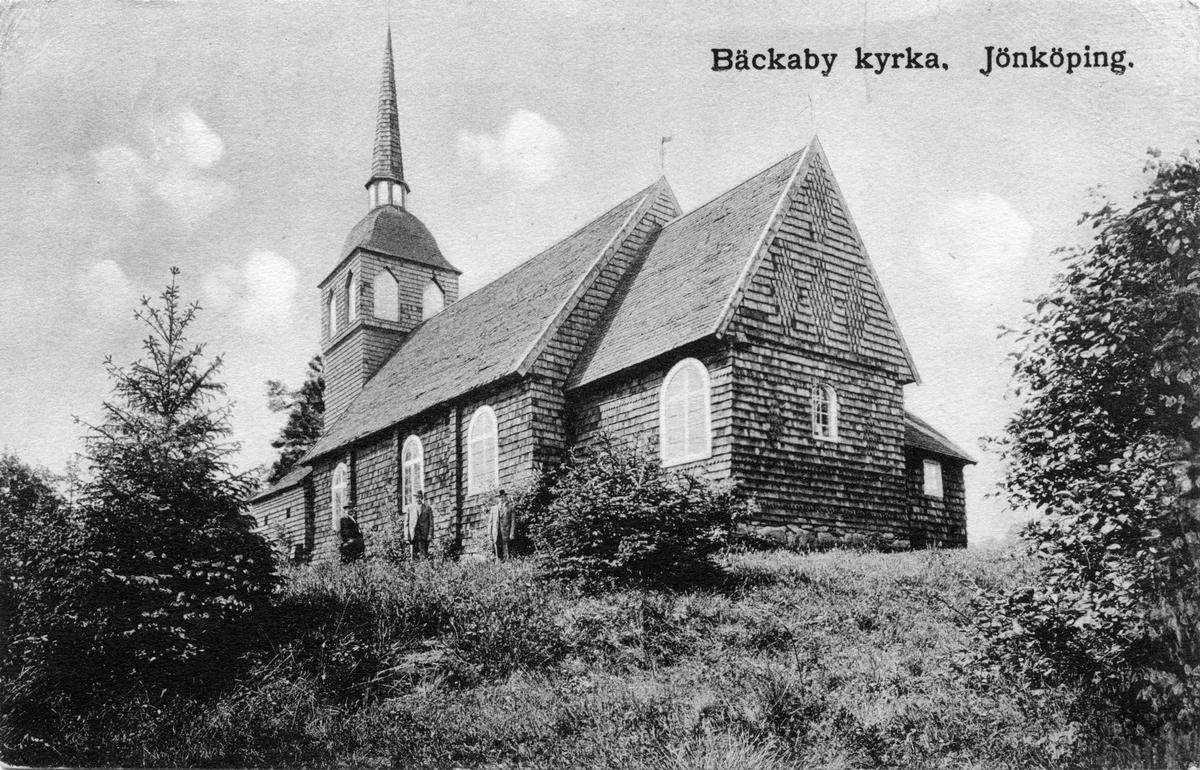 Vykort av Bäckaby kyrka i Jönköpings stadspark, skrivet 1917-08-28. Den gamla träkyrkan köptes in av en privatperson och återinvigdes den 31 augusti 1902 i Jönköpings stadspark efter att ha flyttats dit från Bäckaby utanför Vetlanda 1902. De äldsta delarna av kyrkan var från 1320-talet. Sent på fredagskvällen den 28 april år 2000 totalförstördes kyrkan i en brand.