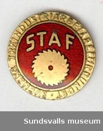 STAF- Svenska träindustriarbetareförbundet. Feltryck på den första upplagan av märket, i saknas.  Ett nytt märke utkom senare med namnet STIAF.  Märket utkom 1949.