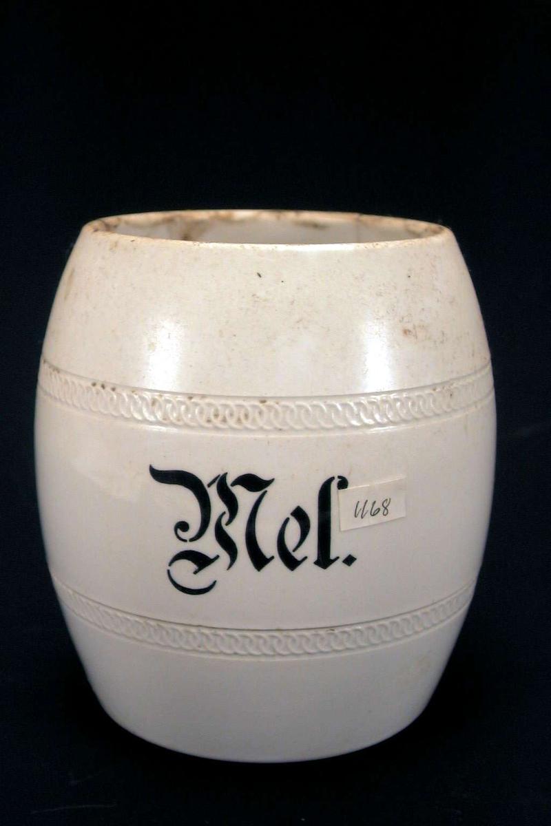 Tønneformet melkrukke i gråbeige keramikk.