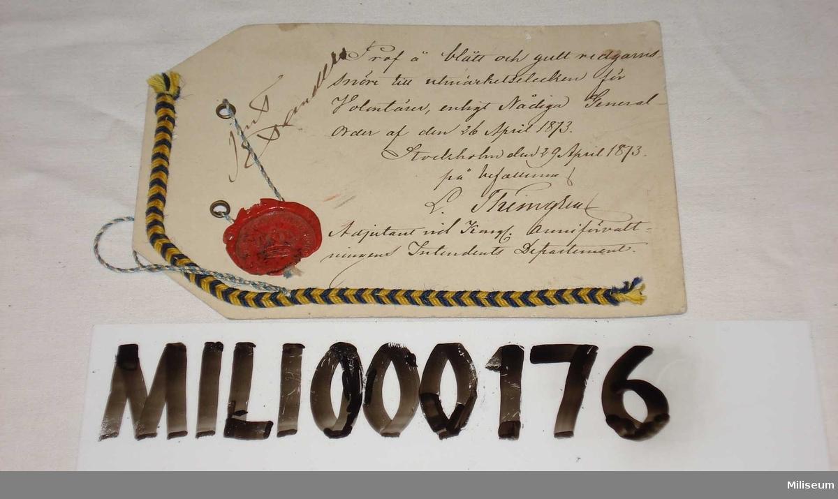"""Prov på redgarnssnöre m/1873 för volontärer (""""studentsnöre"""")"""